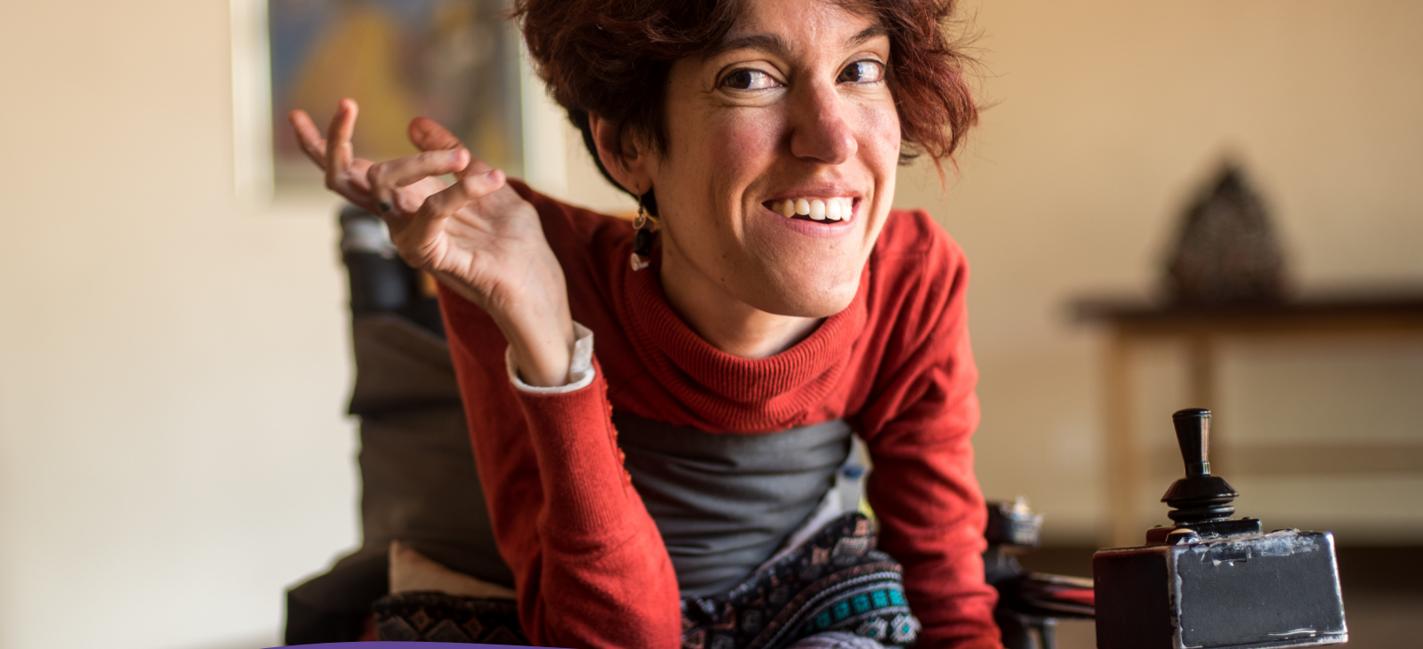 Photo of a woman with a physical disability in a mobility chair
