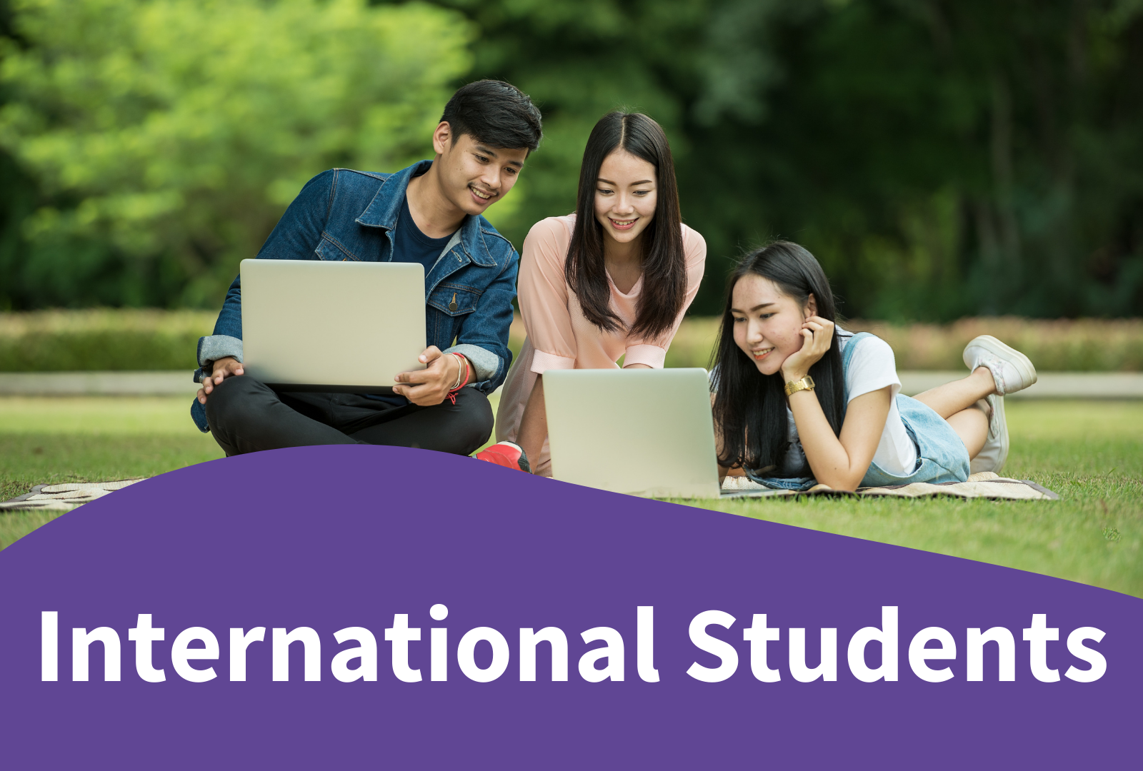 Photo of 3 students in a park - International students