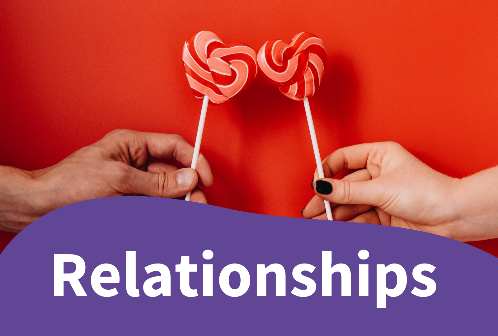 Photo of 2 loveheart shaped lollipops - relationships