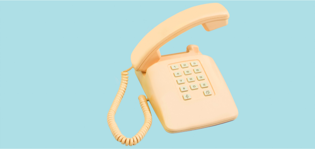 Photograph of an old telephone on a light blue background